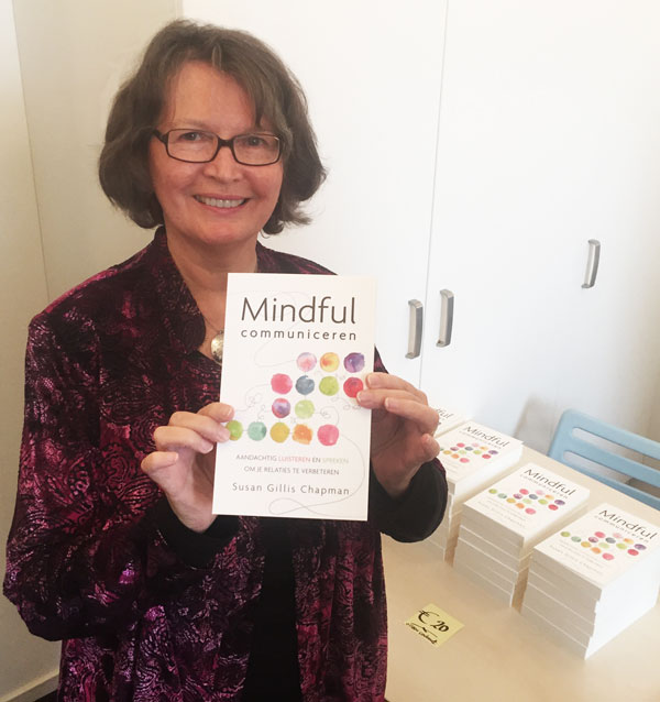 Susan Gillis Chapman holds the Dutch version of The Five Keys to Mindful Communication at the Center for Mindfulness in Amsterdam.